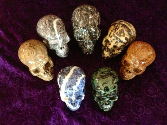 Some of My Divination Skulls--Clockwise From Bottom Two: Kambaba Jasper, Sodalite, Stromatolite Fossil, Crinoid Fossil, Unknown, Chinese Painting Stone, Elephant Skin Jasper